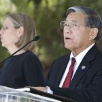 Norman Mineta speaking at the podium