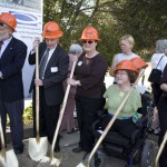 Jan Garrett and others posing with hardhats and shovels