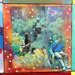 One panel of the Disability Mural. Three wheelchair users going through the woods