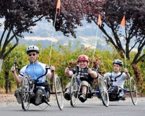 Cyclists using adapted cycles