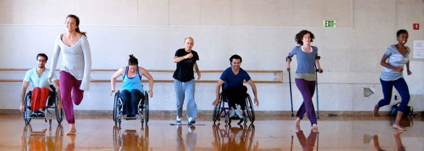 Wheelchair users and other people with disabilities being active in a dance studio.